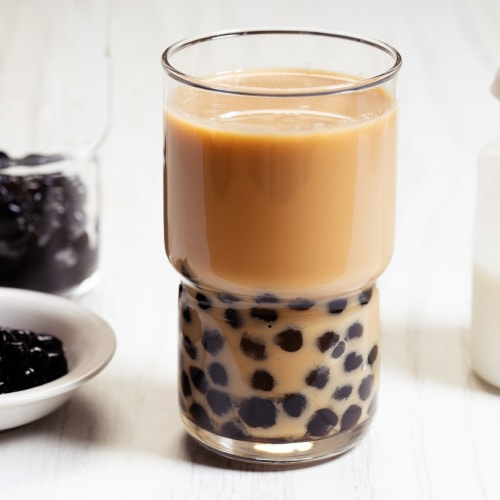 Bubble tea ingredients, glass of bubble tea, and boba pearls