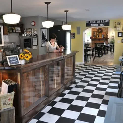 check-out counter and checkered floor at Rachel's Cafe & Creperie