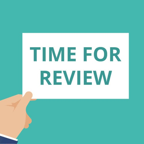 illustrated hand holding a paper that says Time For Review
