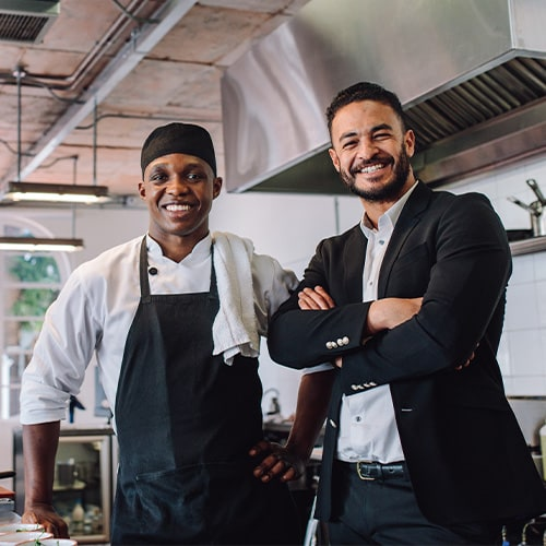 Restaurant owner with a chef in the kitchen
