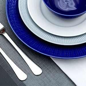 Charger plate under dinner plate
