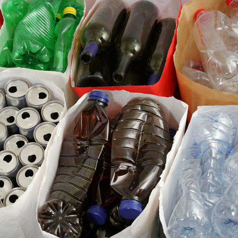 plastic bottles and aluminum cans in recycle bins