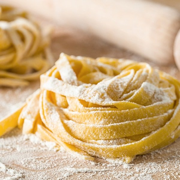 Fresh pasta on a table with flour