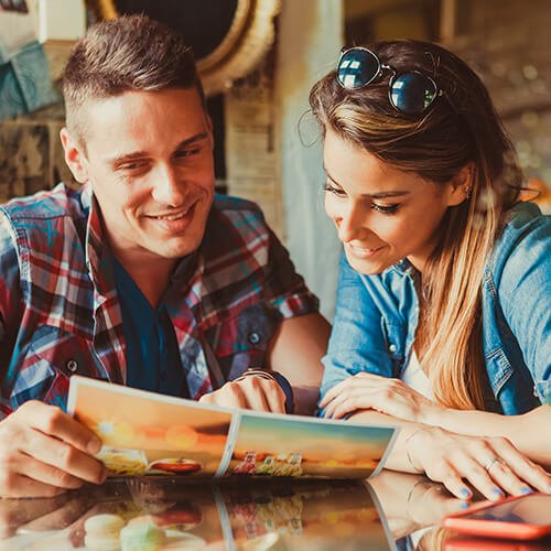 Couple choosing from restaurant menu