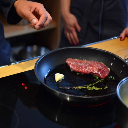 steak being cooked in induction cookware